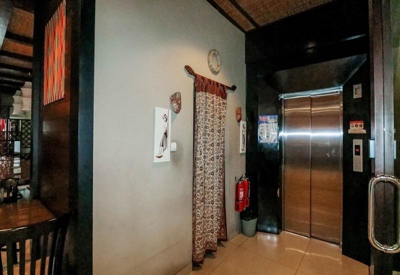 NIDA Rooms Raya Dukuh Kupang 50 Surabaya - Mengangkat