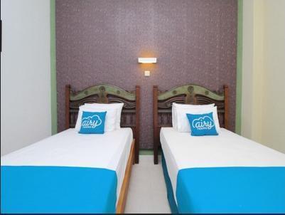 Airy Mantrijeron Panjaitan 51 Yogyakarta - Deluxe Twin Room with Breakfast Special Promo Jan 5