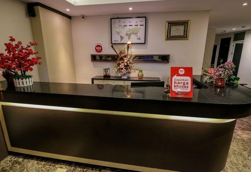 NIDA Rooms Makassar Banda - Resepsionis