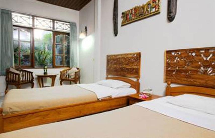 Agung and Sue Watering Hole II Sanur - Kamar tidur