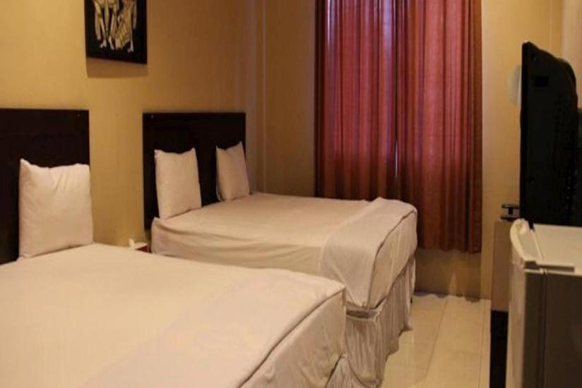 Hotel Sing A Song Pematangsiantar - Triple Room Breakfast Regular Plan