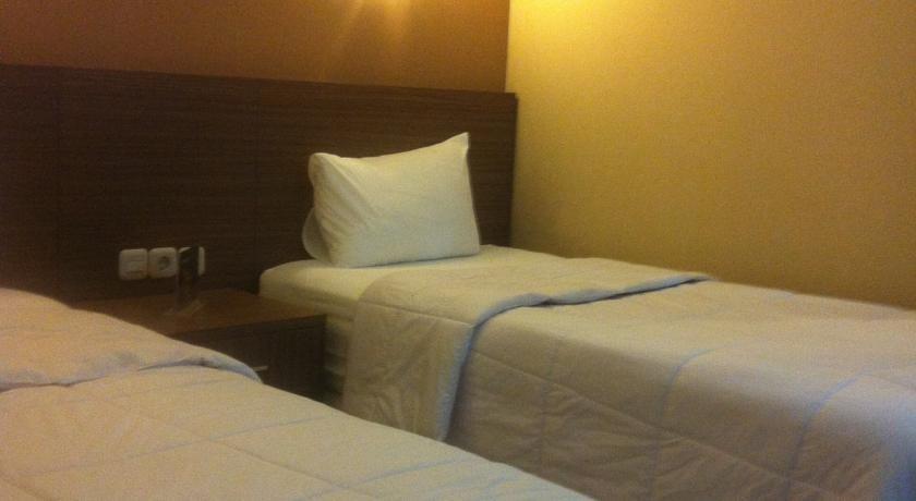 Tirta Mansion Tangerang - bed