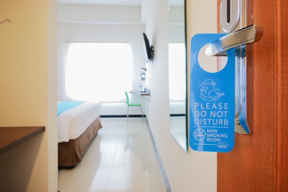 Airy Panakkukang Pandang Raya 12 Makassar - Door Hanger
