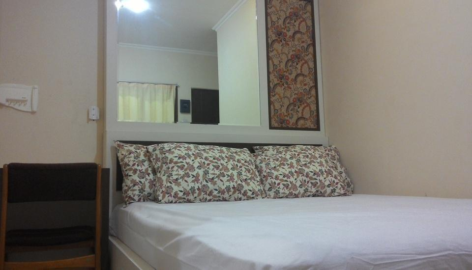 Kantos Guest House Jakarta - Kamar tidur utama pada tipe kamar family.