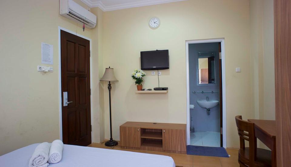 RedDoorz @Kwitang Jakarta - RedDoorz Room Special Promo Gajian