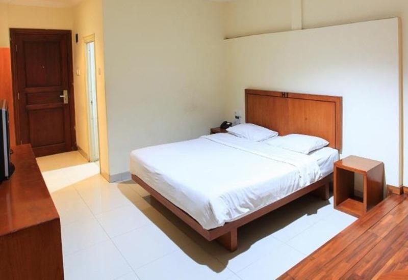 Home Inn Palembang - Kamar tamu