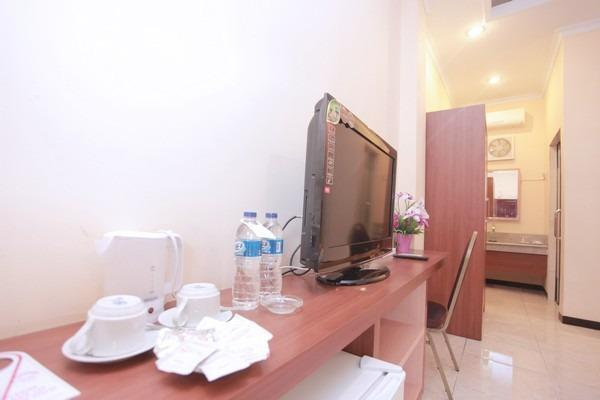 Hotel New Merdeka Pati - Executive Room ( Double + Single ) Regular Plan