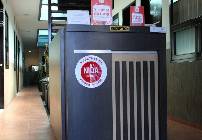 NIDA Rooms Purus 12A Padang Barat - Resepsionis