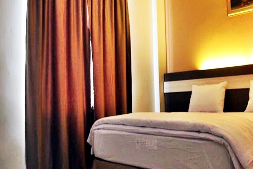Guest Hotel Manggar Manggar - Kamar Deluxe