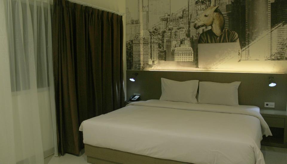 Opi Indah Hotel by Amazing Palembang - Superior Double Room Regular Plan