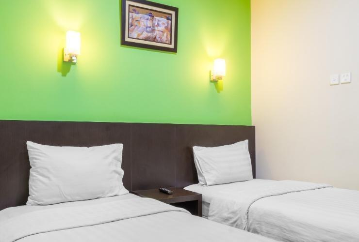 Alpha Inn Medan - Deluxe twin room
