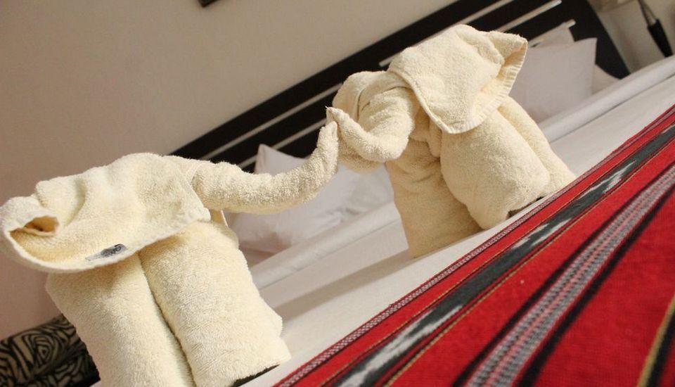 Ollino Garden Hotel Malang - Towel