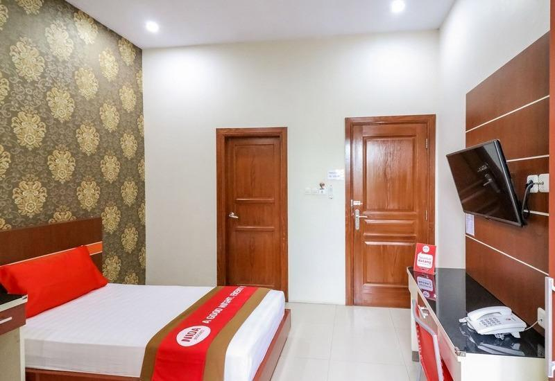 NIDA Rooms Queen Place Makassar - Kamar tamu