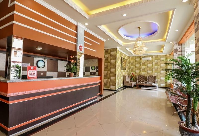 NIDA Rooms Queen Place Makassar - Resepsionis