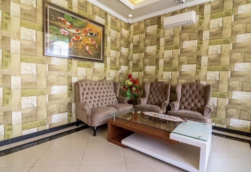 NIDA Rooms Queen Place Makassar - Ruang tamu