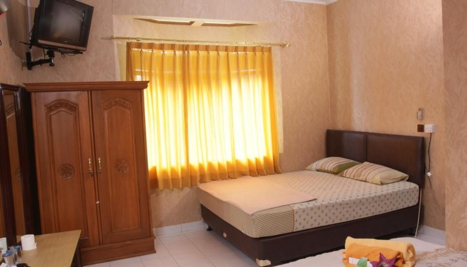 Orange Home Bandung - Standard Quad Room Only Regular Plan