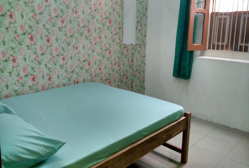 Kamar penginapan di Ayomi Homestay