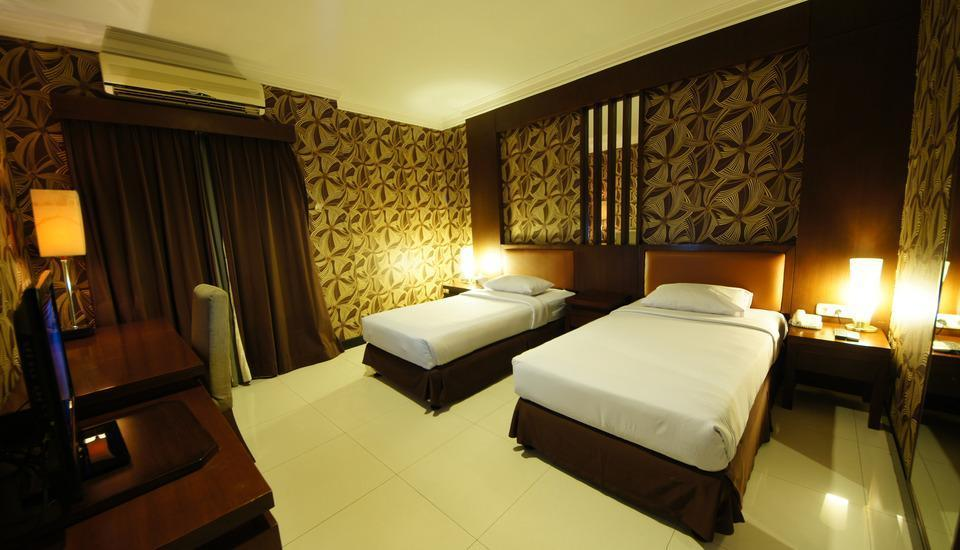 Hotel Tematik Jakarta - twin bed in deluxe room