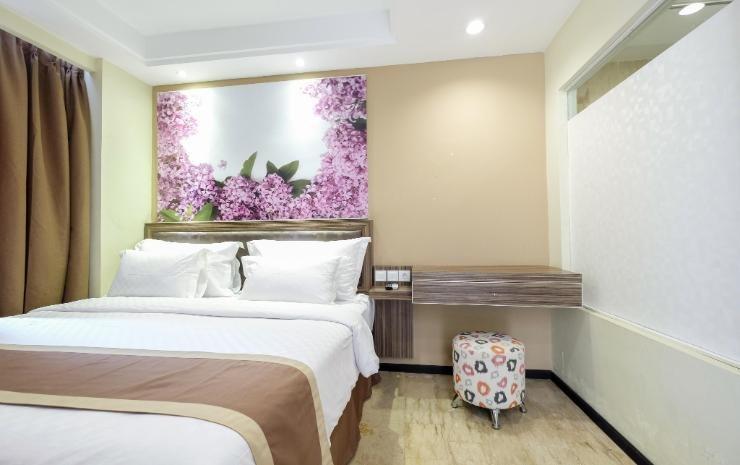 Travellers Hotel Phinisi Makassar - Deluxe Room