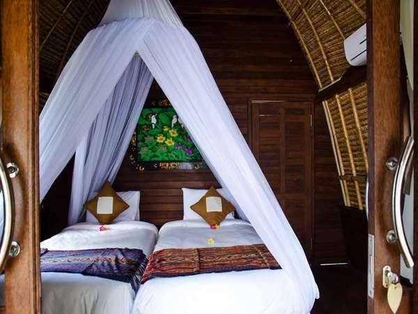 Lotus Garden Huts Bali - Kamar tidur
