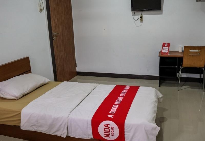 NIDA Rooms Muara 16 Polonia - Kamar tamu