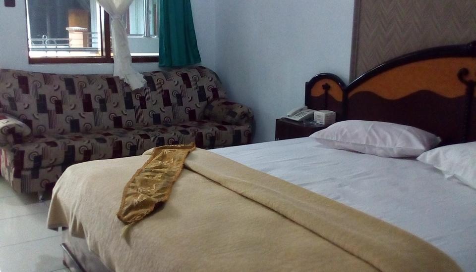 Hotel New Merdeka Jember - Kamar tamu