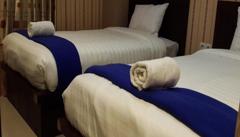 Elfah Hotel Manado - Kamar tamu