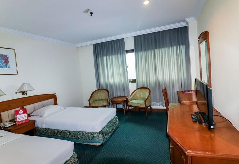 NIDA Rooms Bogor Jalan Pangrango 246 Bogor - Kamar tidur