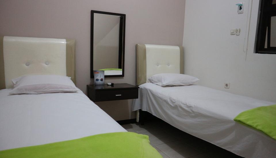 Mitra Guest House Jember - Deluxe Room Regular Plan