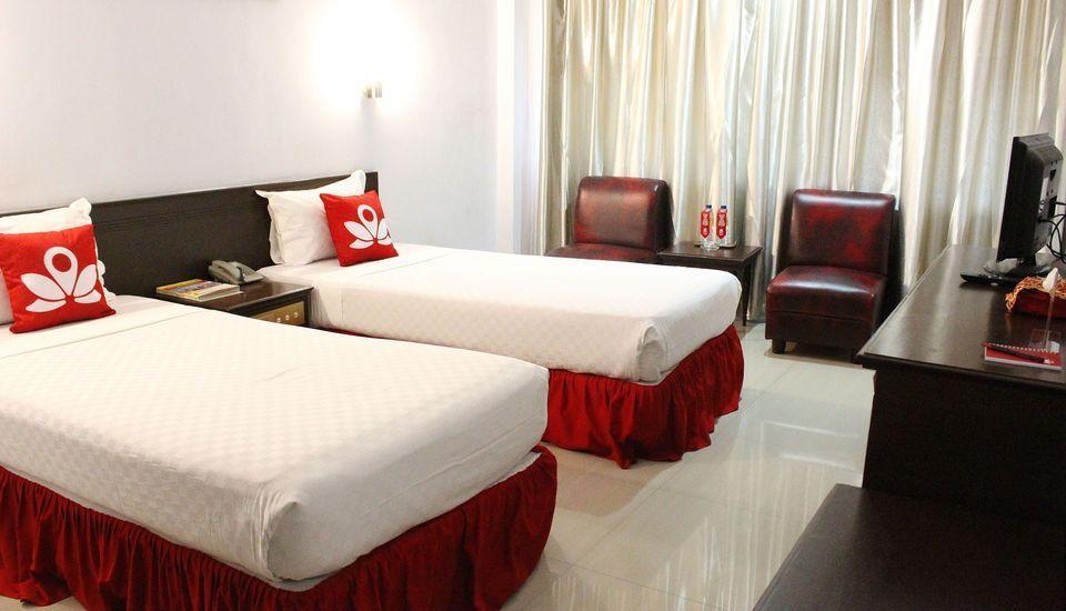 ZenRooms Sam Ratulangi Makassar - Tampak tempat tidur twin