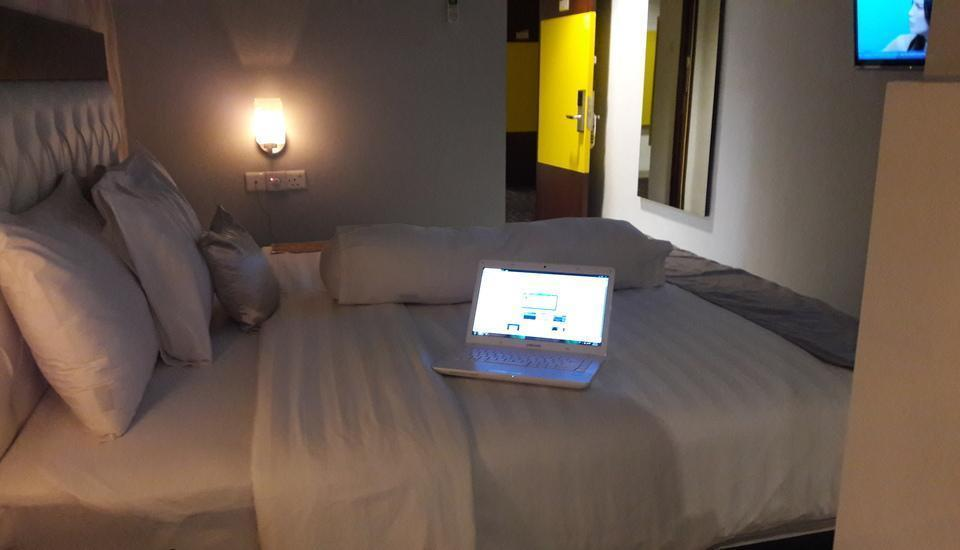 Kaliban Hotel Batam - DELUXE SATU BED