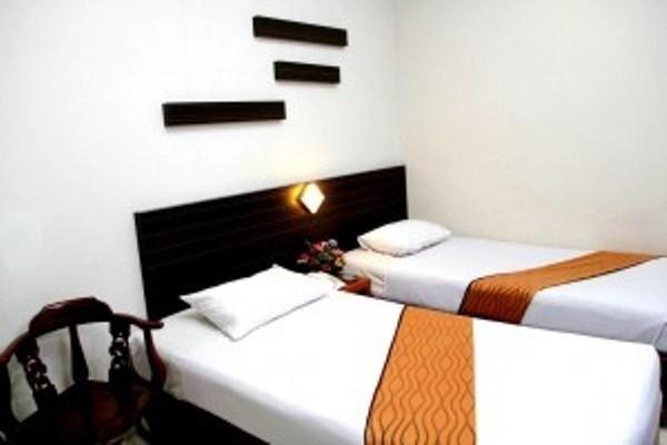 Hotel Dharma Utama Pekanbaru - Suite Twin Regular Plan
