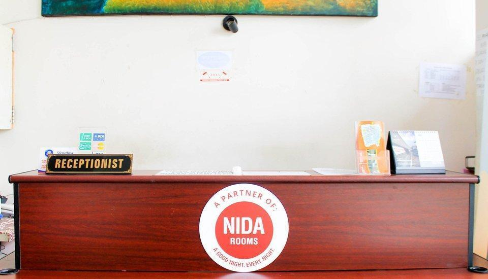 NIDA Rooms Jembatan Merah Depok Jogja - Resepsionis