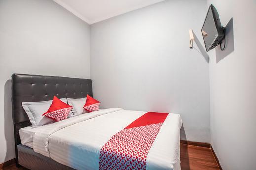 OYO 842 Arafuru Residence Near Rs Duren Sawit Jakarta - Bedroom
