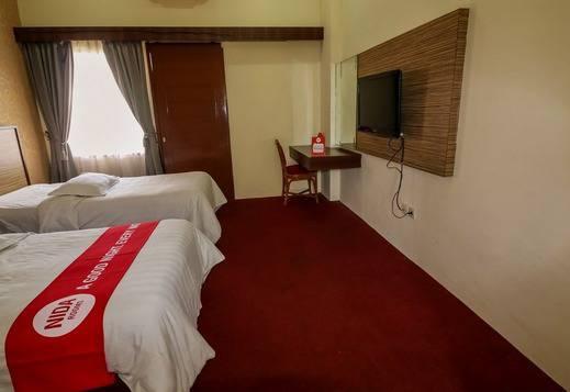 NIDA Rooms Wisata Kullner Medan - Kamar tamu