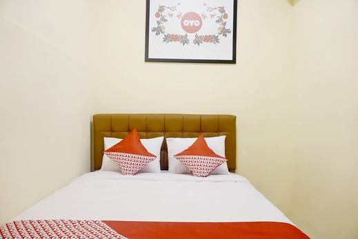 OYO 702 Ganesha Homestay Pekanbaru - standard double bedroom