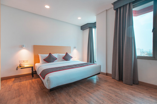 OYO Townhouse 1 Hotel Salemba Near RS PGI Cikini Jakarta - Bedroom