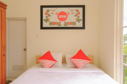 OYO 414 Loji Rejo Guest House Malang - Bedroom