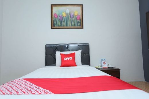 OYO 1864 Tiara Guest House Banjarmasin - Bedroom