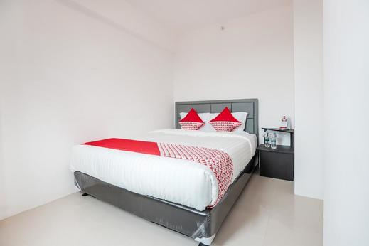 OYO 129 Bassura City Apartment Jakarta - Bedroom