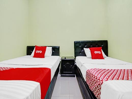OYO 90409 Kostawira Residence Syariah Tangerang Selatan - Bedroom