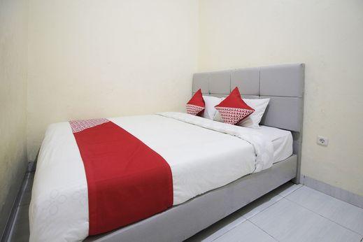 OYO 654 Fabio Guest House Syariah Bandar Lampung - Bedroom
