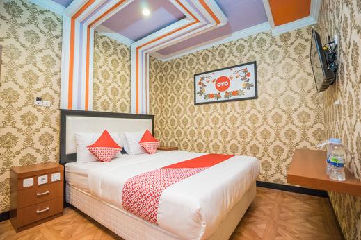 OYO 975 Cita Mandiri Residence Syariah Malang - Bedroom
