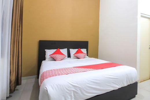 OYO 962 Family Homestay Pekanbaru - Bedroom