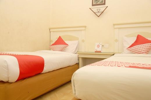 OYO 2870 Wisma Prima Makassar - Bedroom