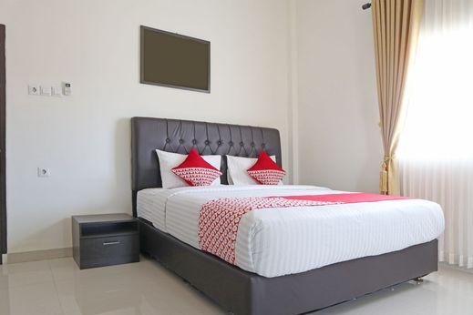 OYO 1326 Mahakam Guest House Padang - Bedroom