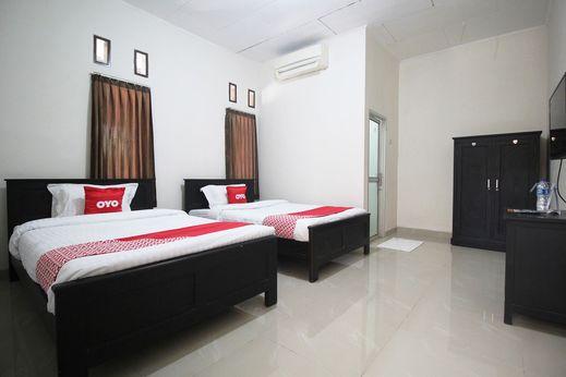 OYO 1547 Wisma Ray Syariah Bandar Lampung - Bedroom
