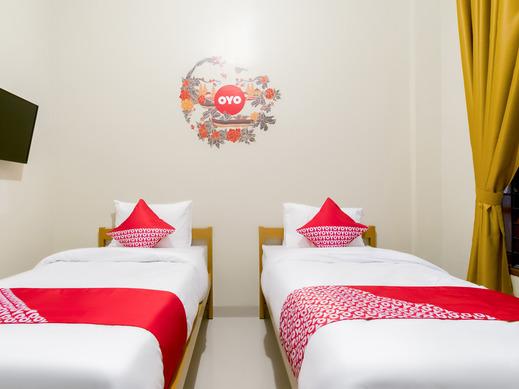 OYO 597 Joyce Guest House Medan - Bedroom ST