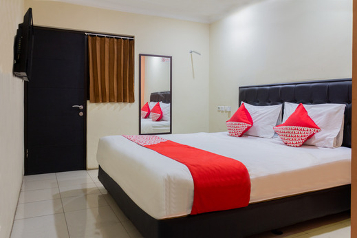 OYO 989 Audah Guesthouse Syariah Jakarta - Bedroom