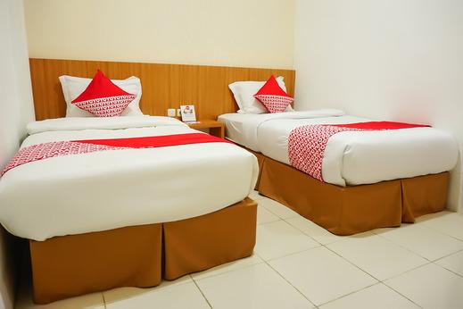 OYO 555 Aedo Bukittinggi - Bedroom